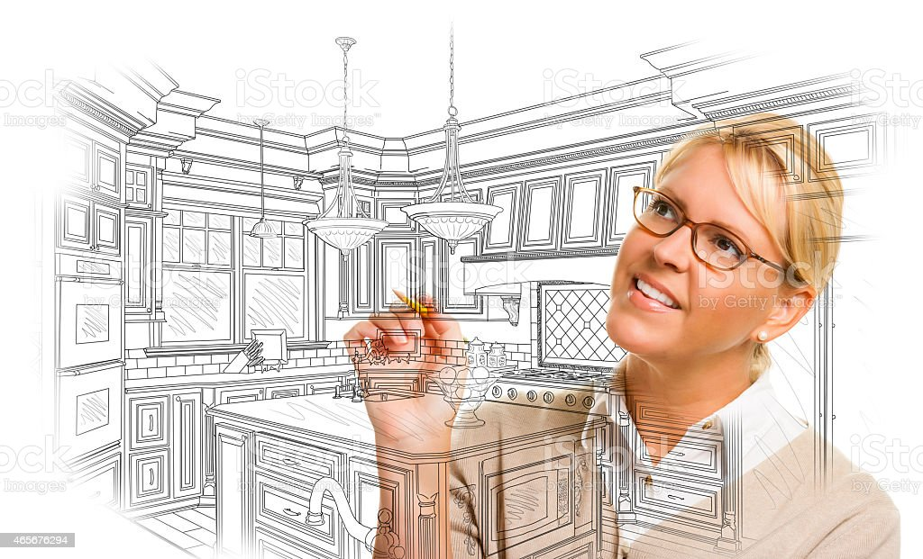 Woman With Pencil Drawing Custom Kitchen Design stock photo