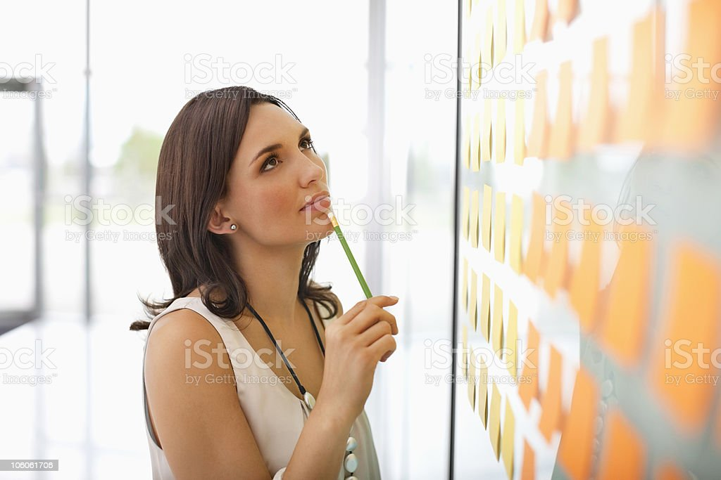 Woman with pencil in her hand planning the schedule royalty-free stock photo
