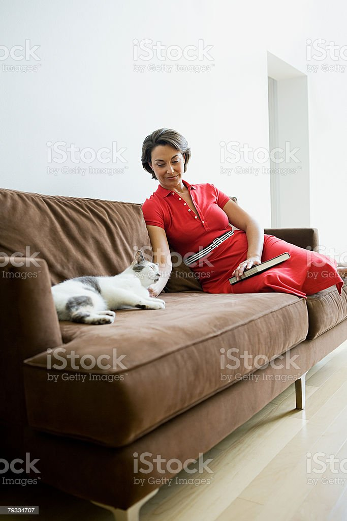 Woman with pet cat stock photo
