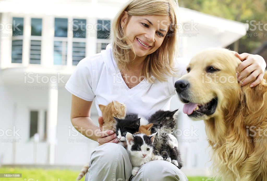 Woman with pets enjoys outdoor. royalty-free stock photo