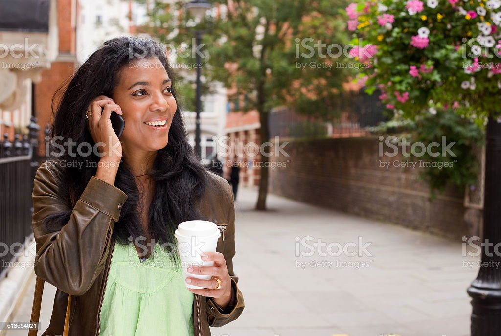 woman with phone and coffee royalty-free stock photo