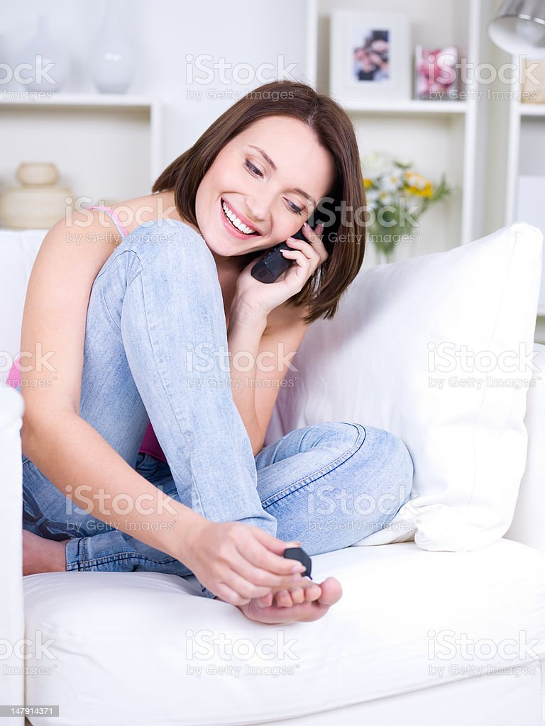 Woman with phone at home royalty-free stock photo