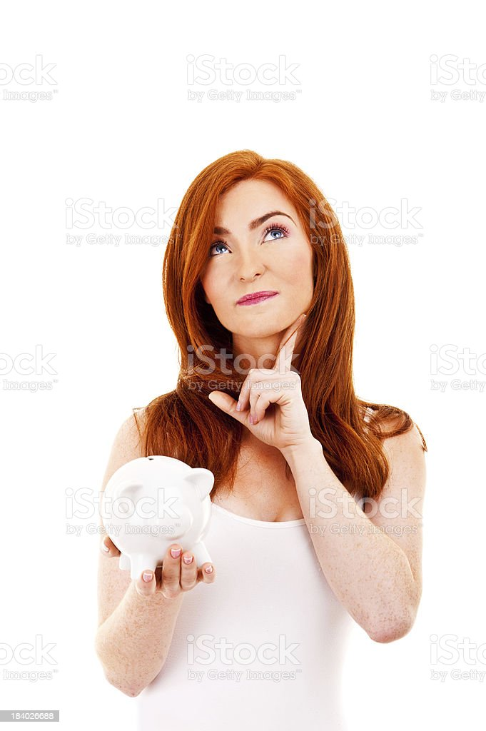 Woman with pig bank looking up royalty-free stock photo