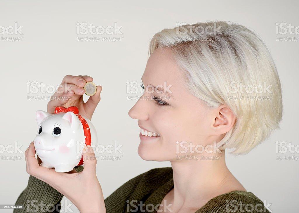 woman with piggybank stock photo