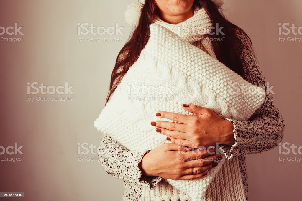 Woman with pillow stock photo