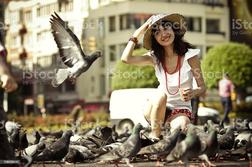 woman with pingueon royalty-free stock photo