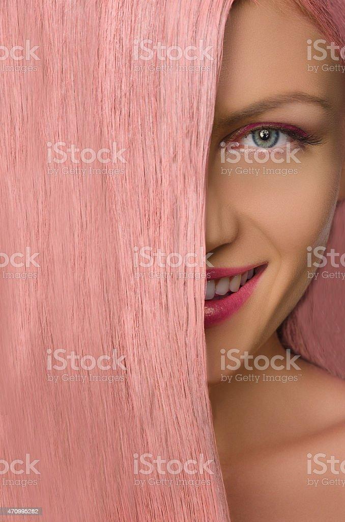woman with pink hair looking at camera stock photo