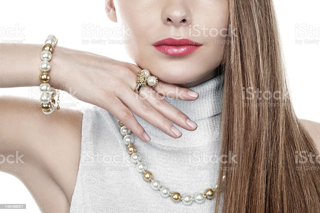 Woman with pink lips showing off her pearl jewelry stock photo
