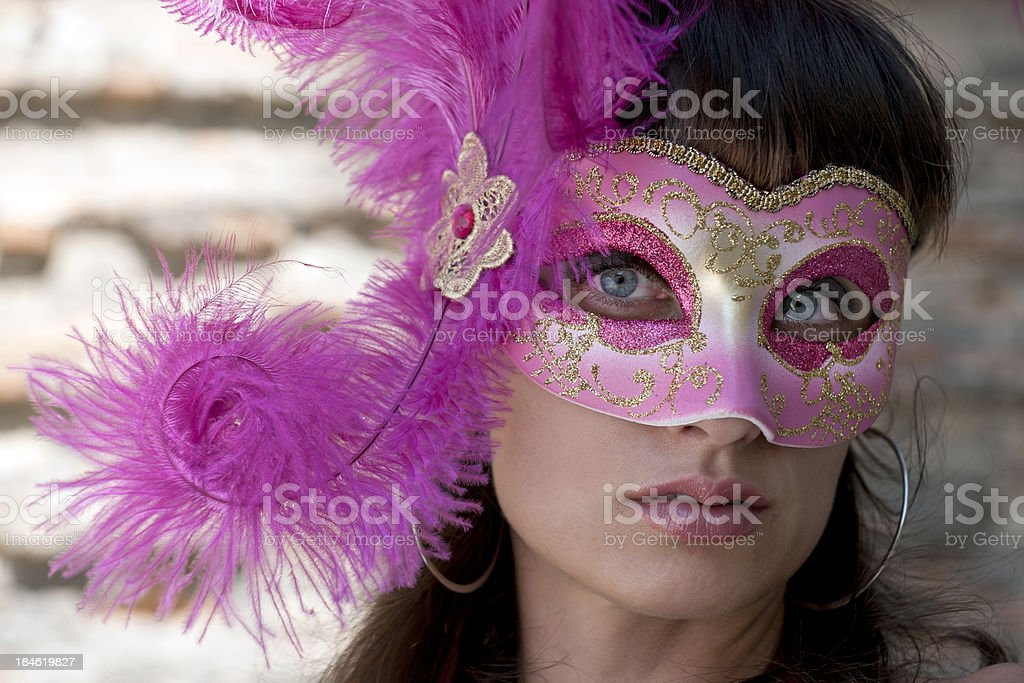 Woman with Pink Mask Hiding in Shadow royalty-free stock photo