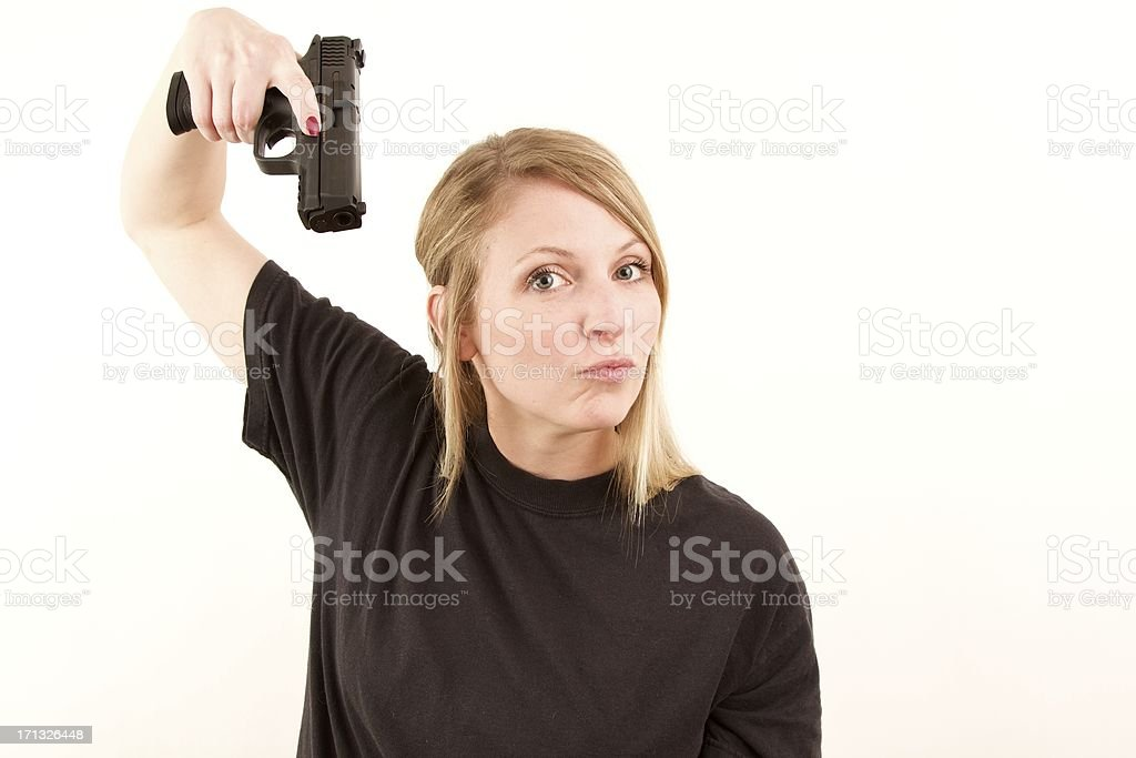 Woman with pistol royalty-free stock photo