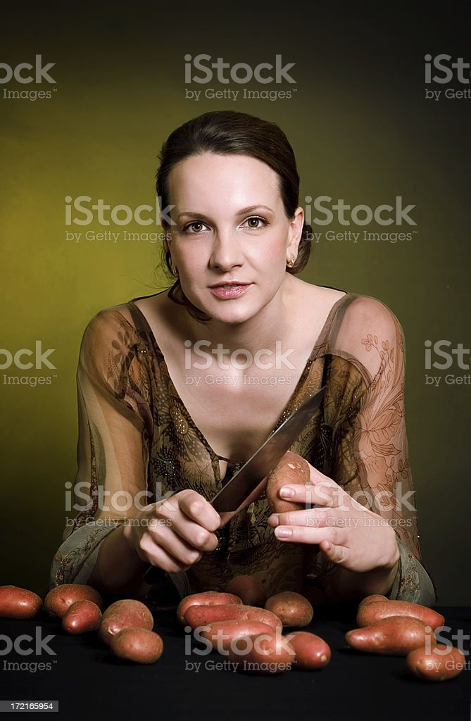 woman with potato royalty-free stock photo