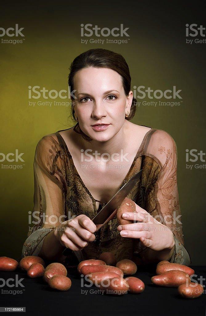 woman with potato stock photo