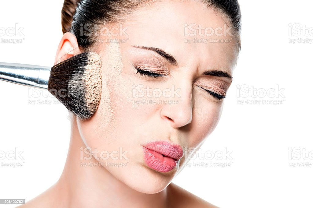 woman with  powder on the skin of cheek stock photo
