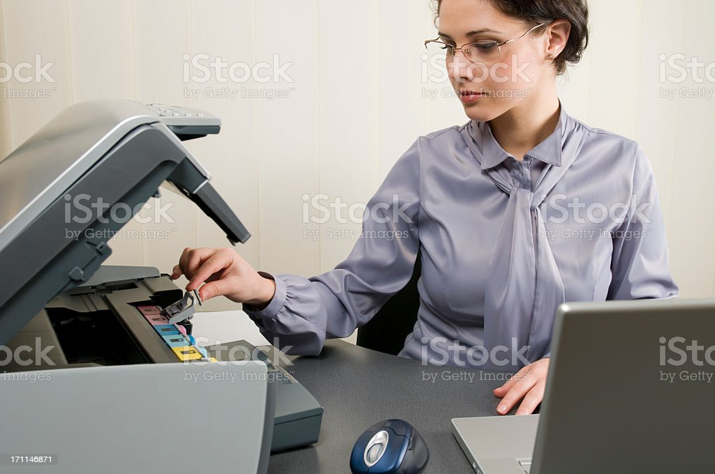 Woman with printer replacing the ink royalty-free stock photo