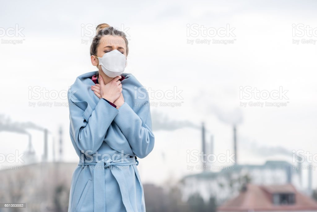 Woman with protective mask outdoors stock photo