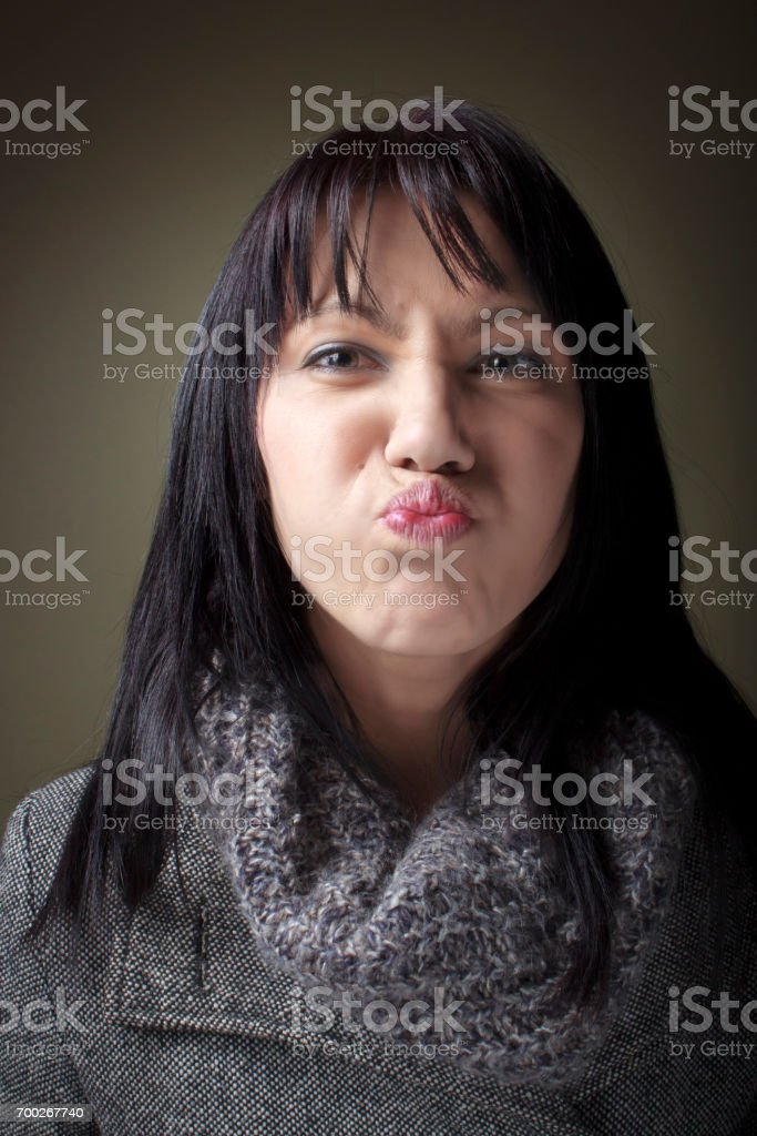 Woman with puckered or pouting lips stock photo