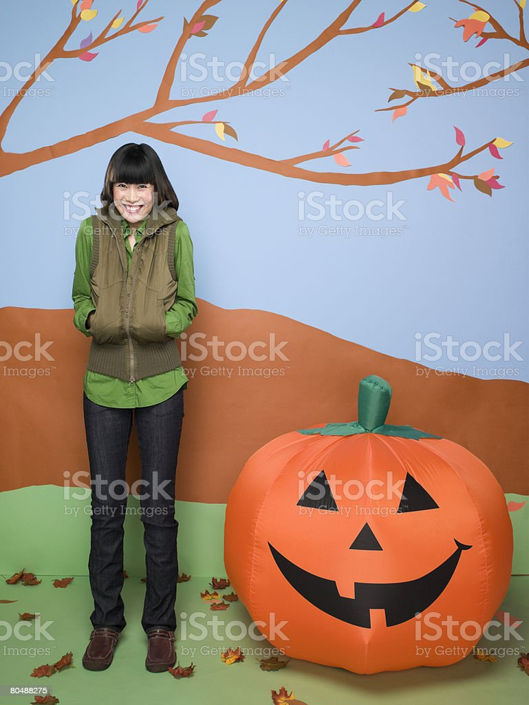 Woman with pumpkin royalty-free stock photo