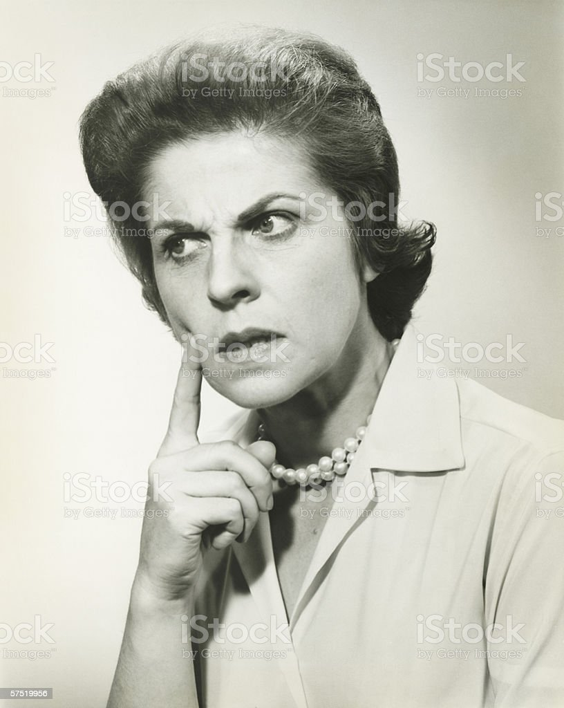 Woman  with puzzled expression, in studio, (B&W), portrait royalty-free stock photo