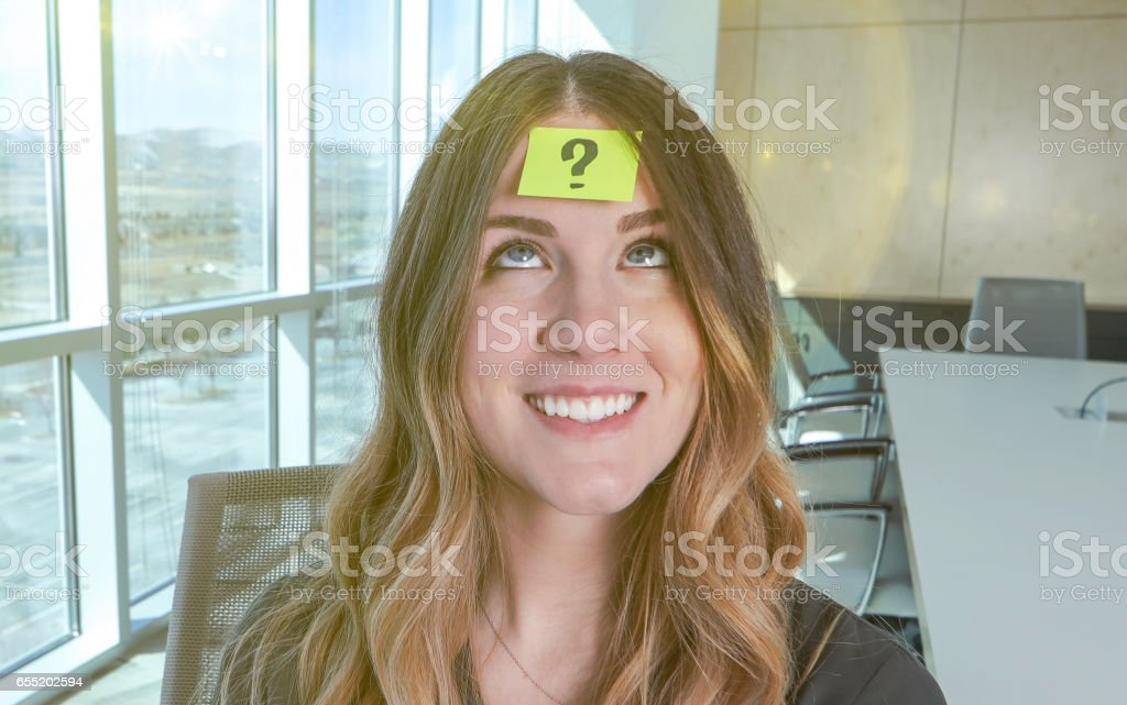 Woman with questions stock photo