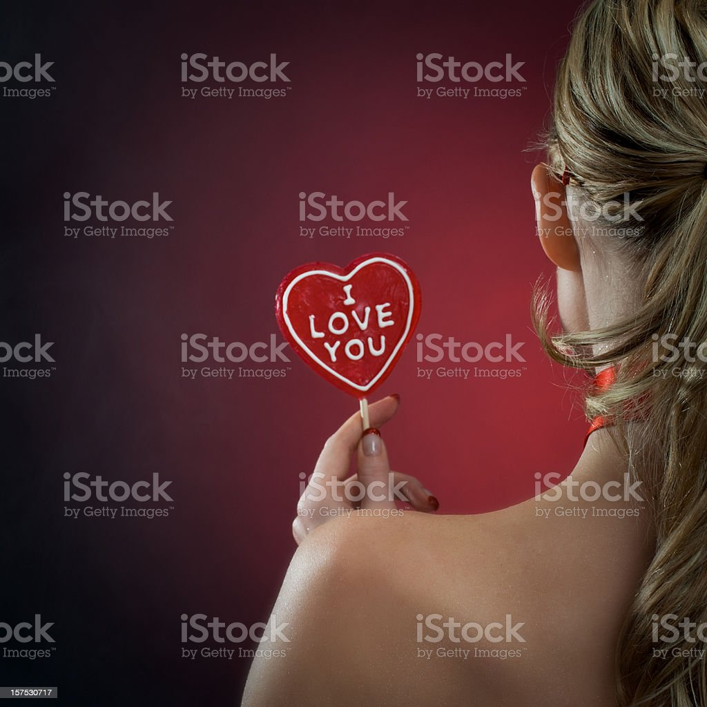 "Woman with ""I love you"" candy royalty-free stock photo"