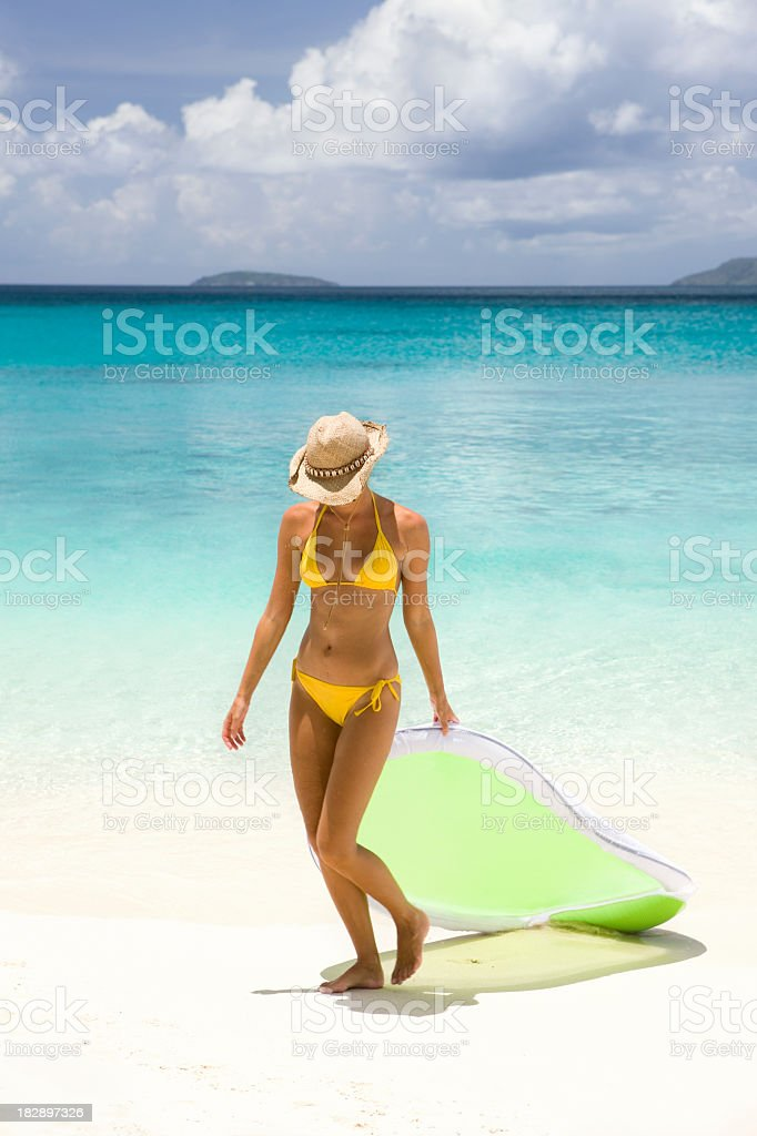 woman with raft on the Caribbean beach royalty-free stock photo