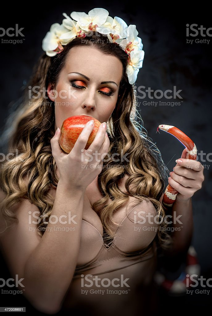 Woman with red apple and snake stock photo