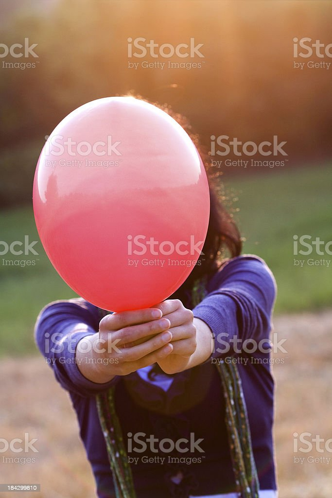 woman with red balloon stock photo
