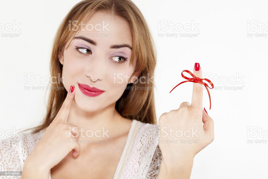 woman with red bow on finger royalty-free stock photo