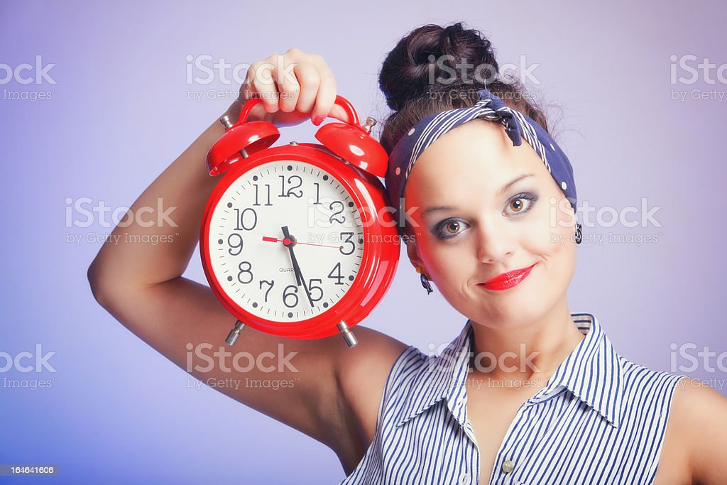 Woman with red clock. Time management concept. royalty-free stock photo