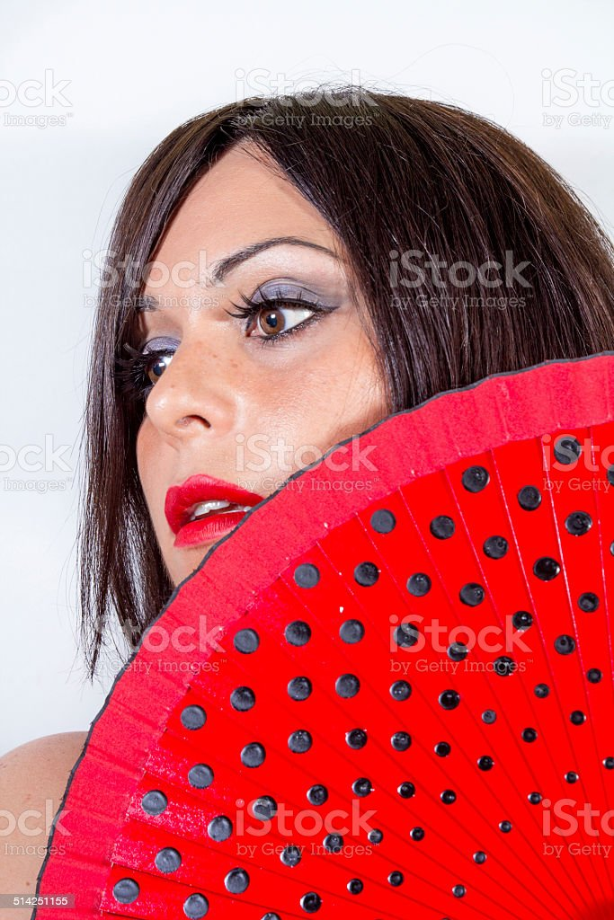 Woman with red fan stock photo