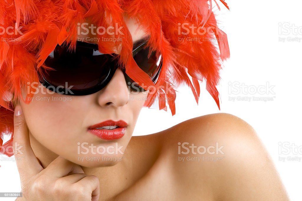 woman with red feather wig and sunglasses royalty-free stock photo