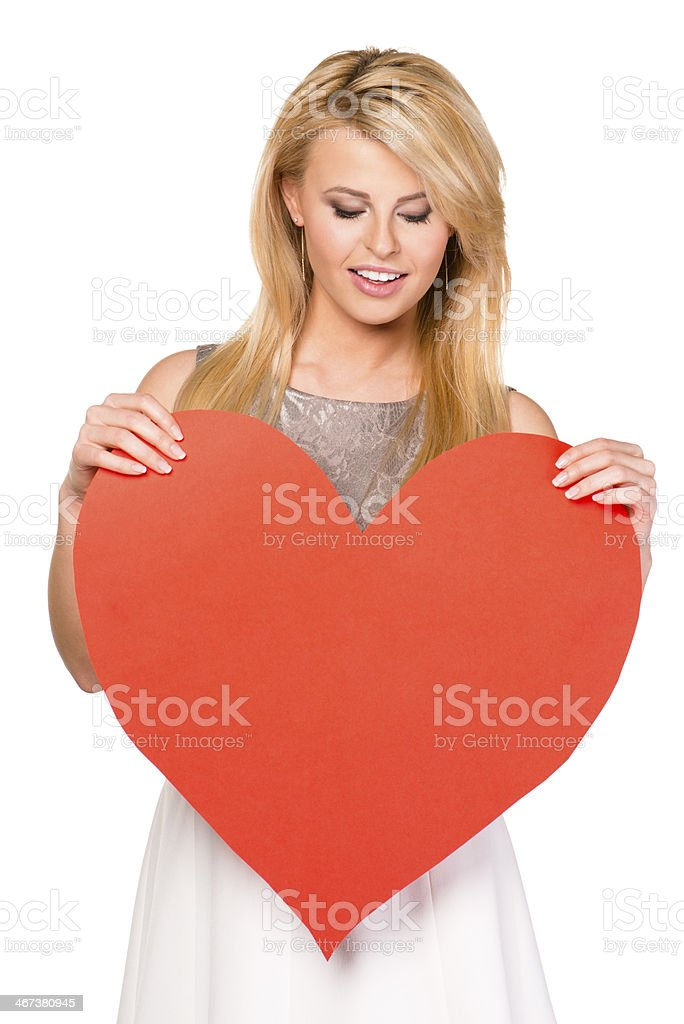 Woman with red heart stock photo