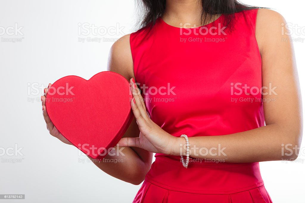 woman with red heart shaped gift box stock photo