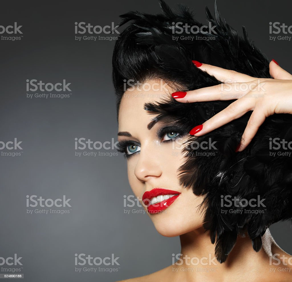 Woman with red nails and creative hairstyle stock photo