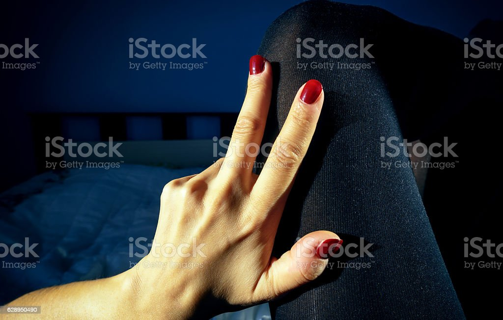 Woman With Red Nails Black Stockings stock photo
