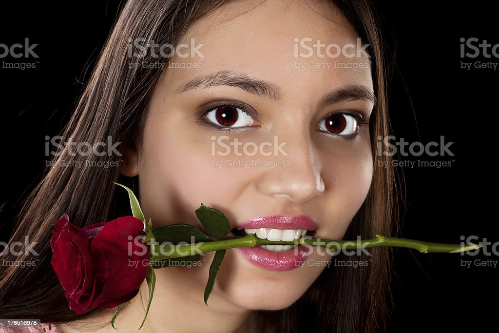 Woman with red rose in her mouth royalty-free stock photo