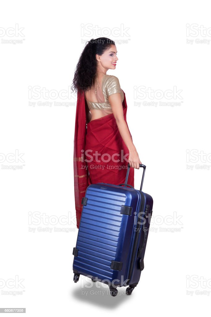 Woman with red saree and suitcase stock photo
