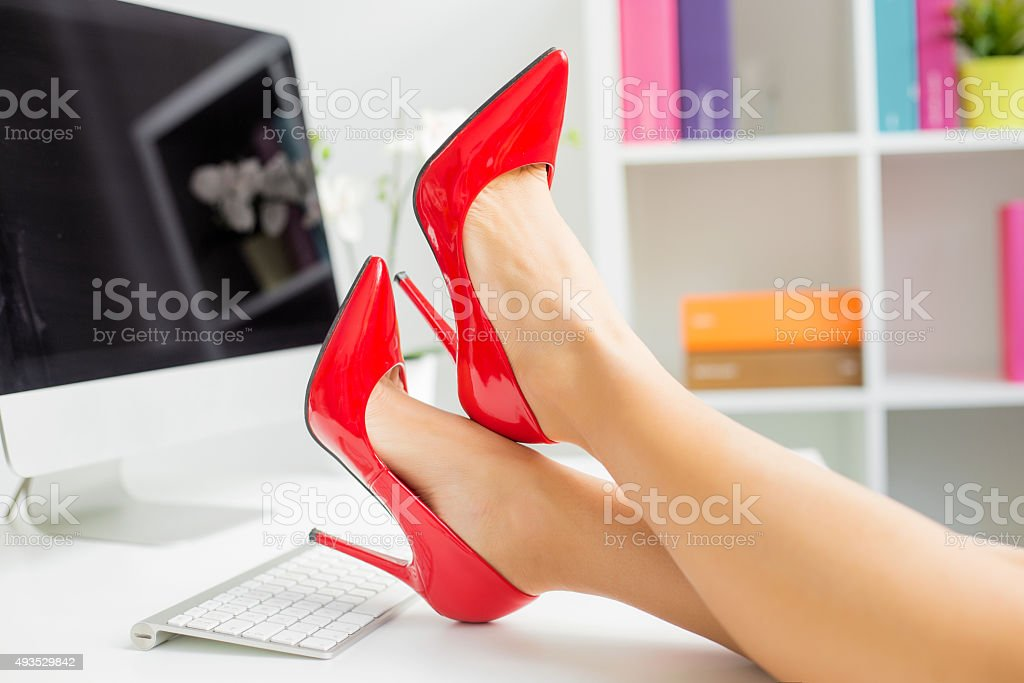 Woman with red shoes stock photo