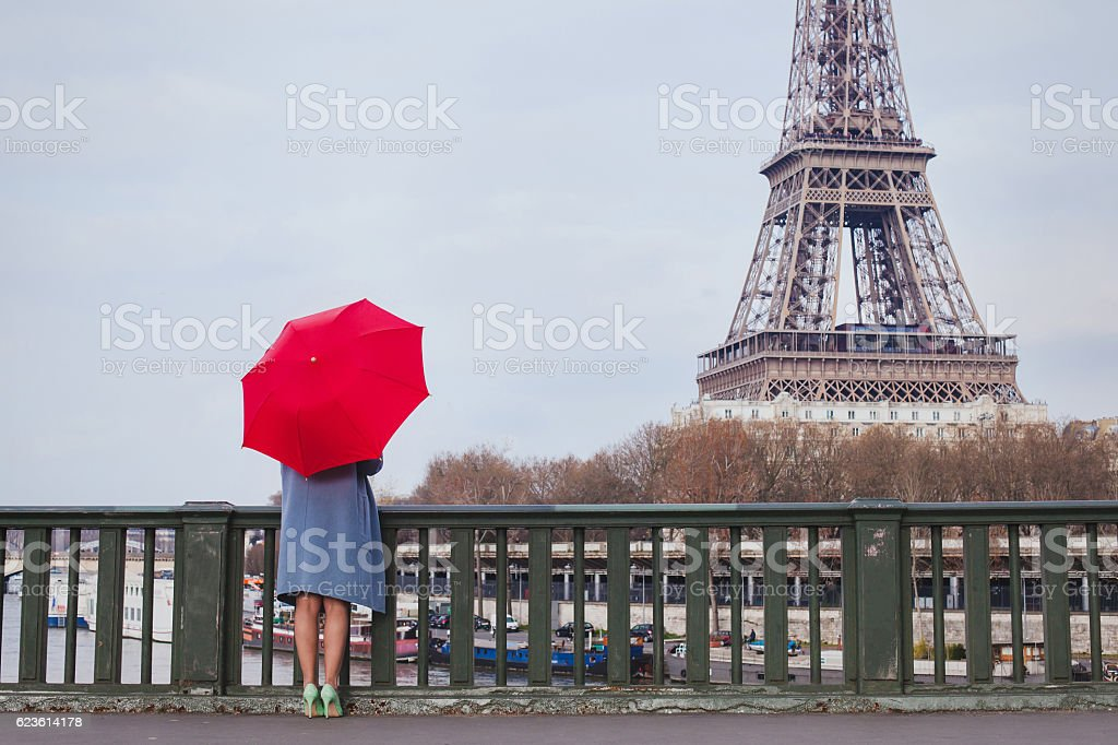 woman with red umbrella in Paris stock photo