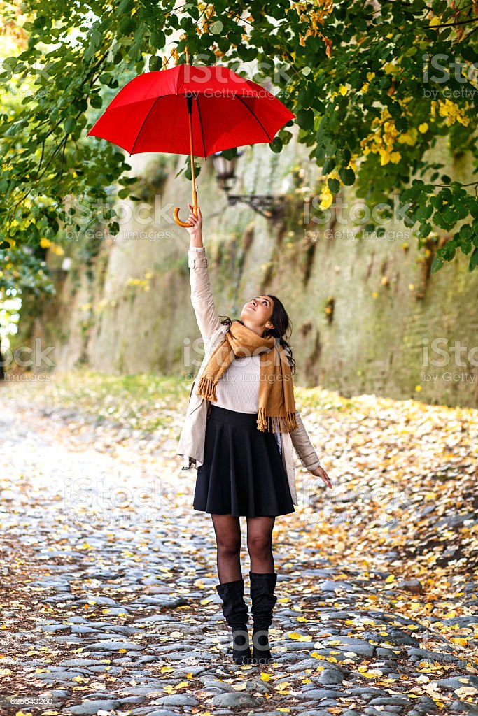 Woman with red umbrella stock photo