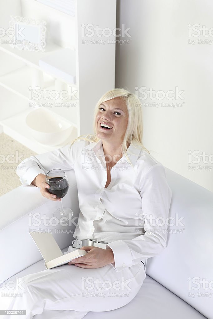 Woman with red wine and book royalty-free stock photo