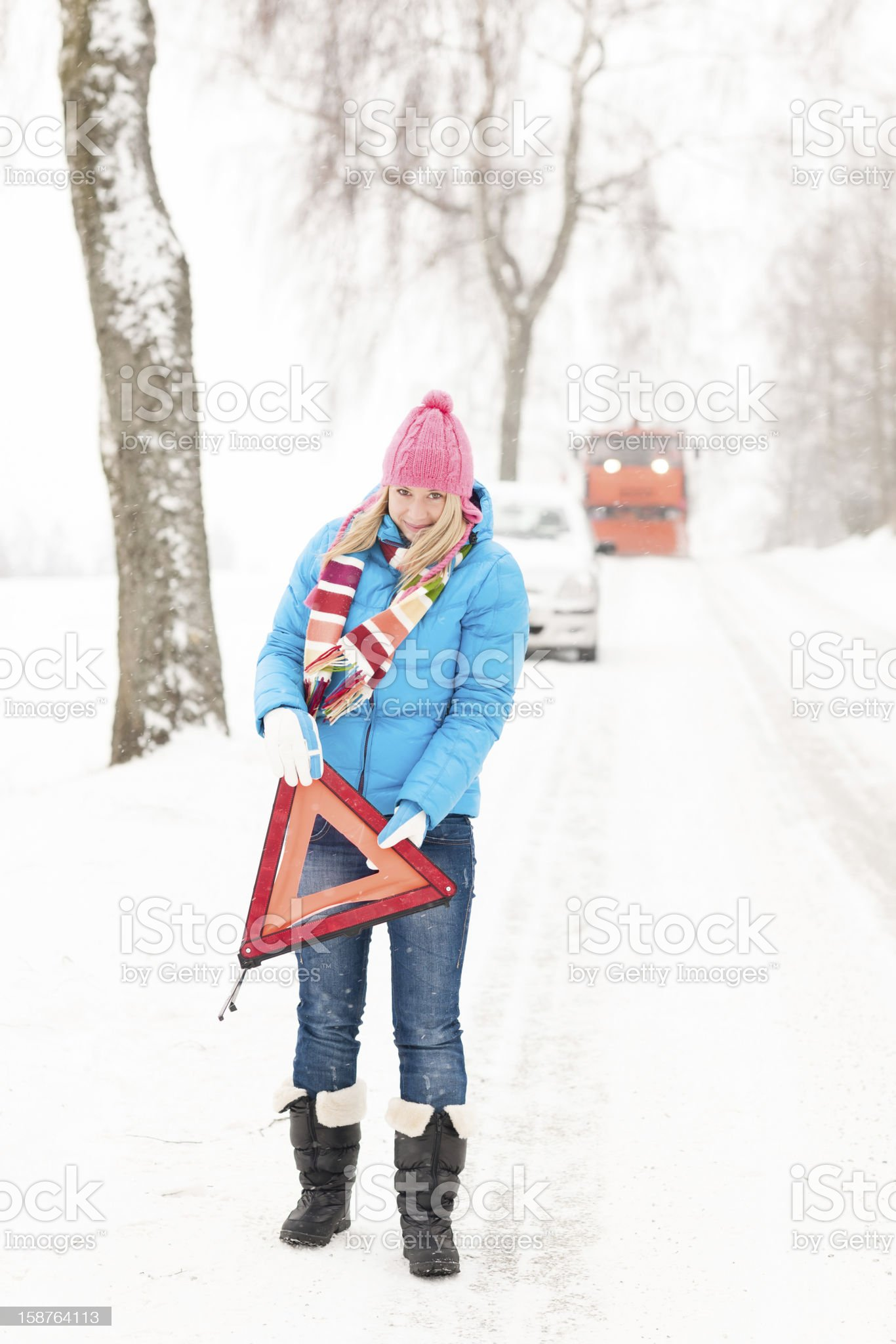 Woman with reflector triangle car snow breakdown royalty-free stock photo