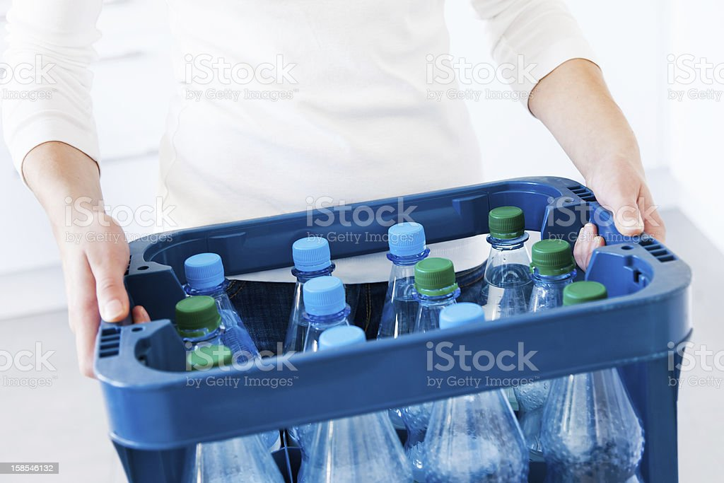 Woman with refundable bottles stock photo
