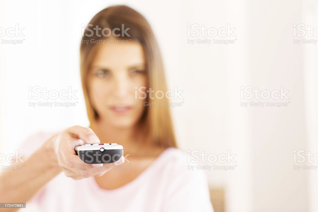 Woman With Remote Control royalty-free stock photo