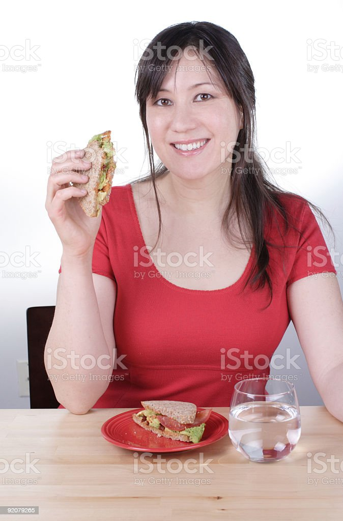 Woman with Sandwhich and Water royalty-free stock photo