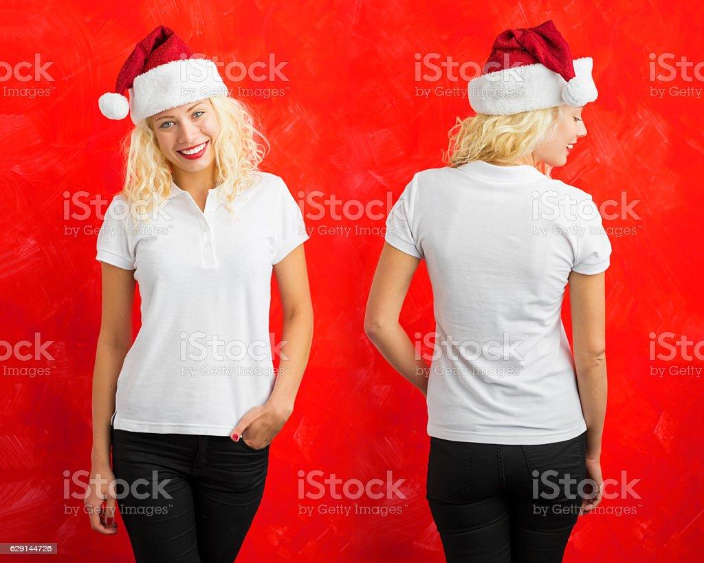 Woman with Santa hat wearing white polo shirt stock photo
