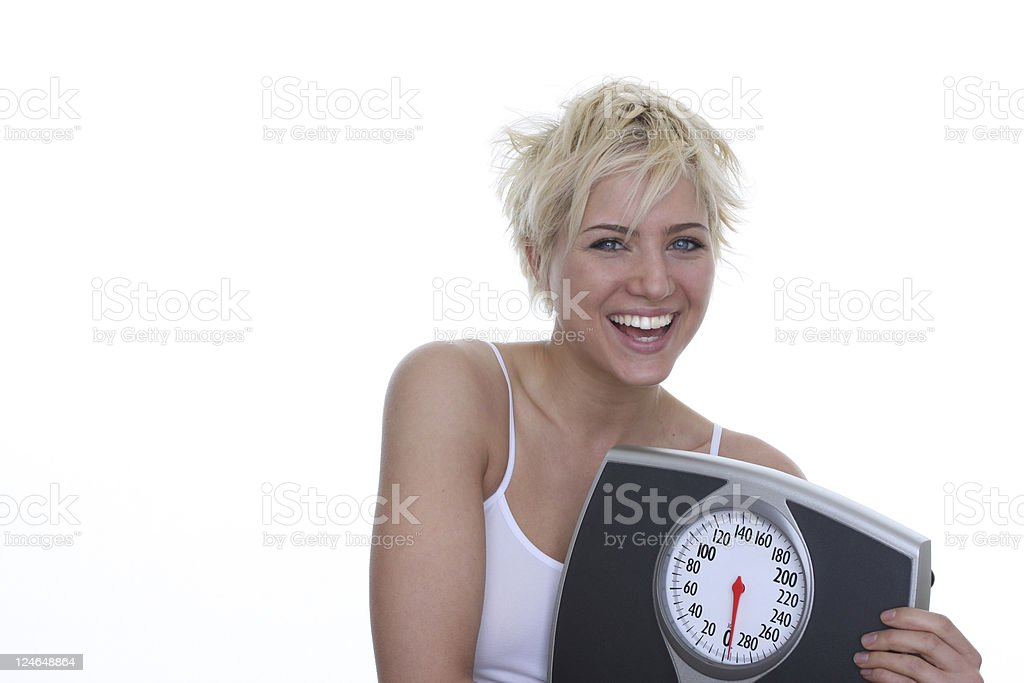 woman with scale stock photo