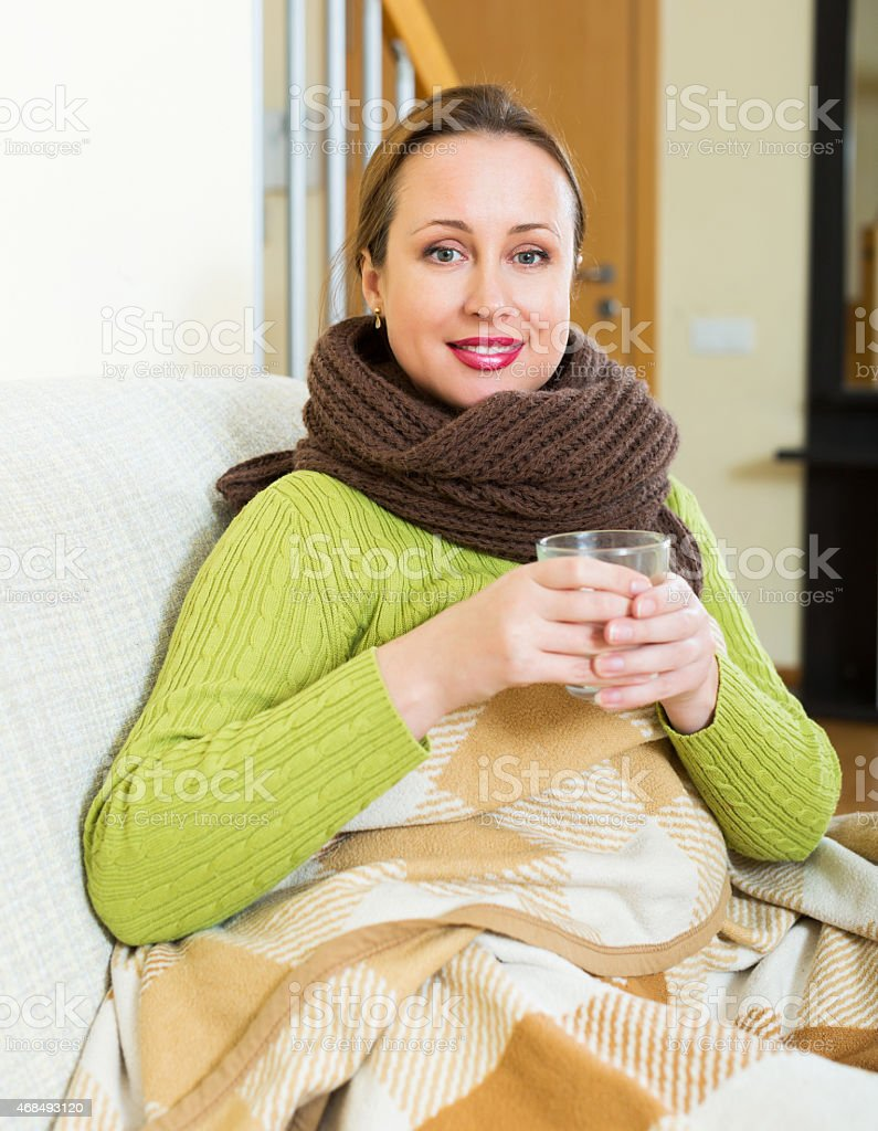 Woman with scarf dissolving medicine stock photo
