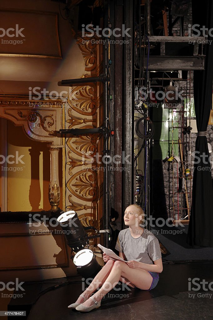 Woman With Script Backstage stock photo