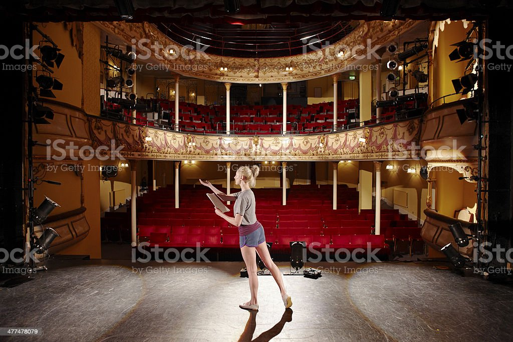 Woman With Script Rehearsing On Stage stock photo